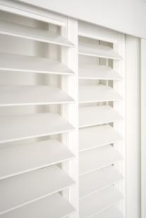 Timber_Plantation_Shutters_Sliding_Headboard_Hidden-Control_Open_White